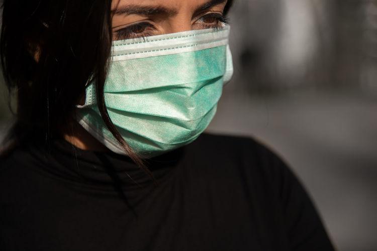 Close-up of woman wearing mask