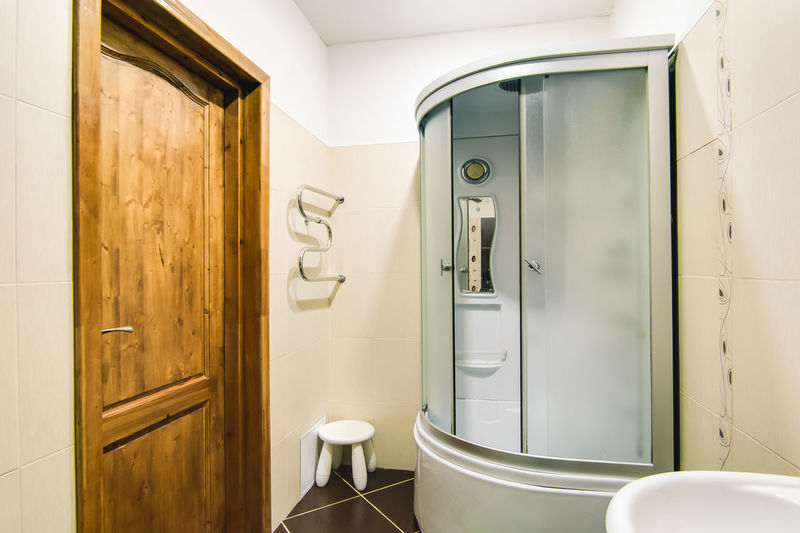 Bathroom Indoors  Door Domestic Room Entrance Hygiene Domestic Bathroom Toilet No People Sink Home Mirror Household Equipment Home Interior Glass - Material Absence Faucet Public Restroom White Color Day Clean