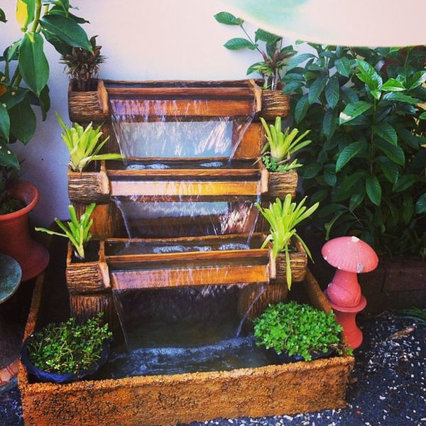mini waterfall in the yard. :) Phayao Chiangkham Newyears Garden waterfall happy