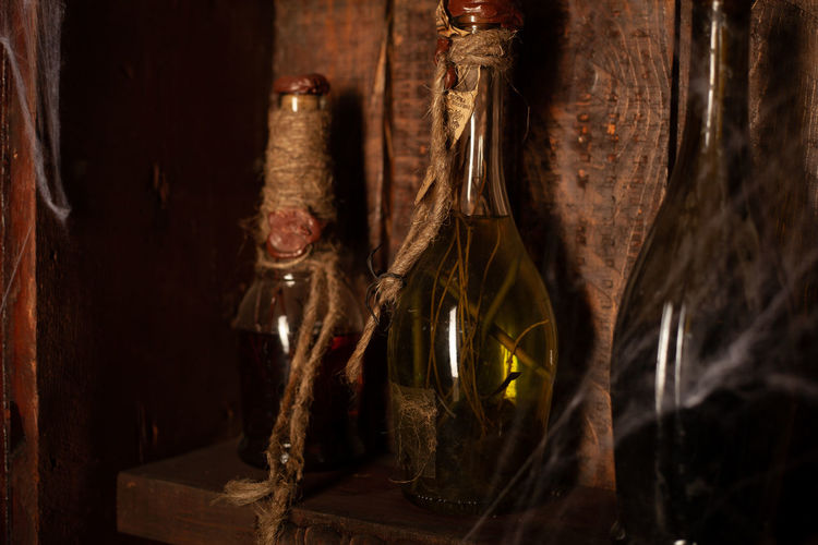 Close-up of glass bottles on shelf