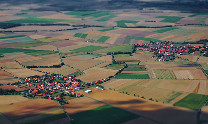Aerial View Agriculture Landscape Patchwork Landscape Field Scenics - Nature Rural Scene Environment Land Farm Tranquil Scene Nature Beauty In Nature High Angle View Tranquility Outdoors Village Neighborhood Germany Lower Saxony Tilt-shift 17.62°