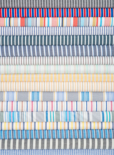 Close-up of multi colored fabrics stacked in row