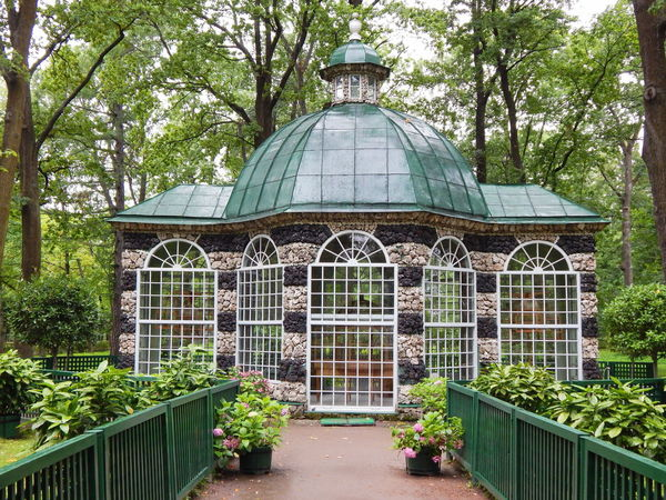 A pavillion for keeping exotic and singing birds in Peterhof in Saint Petersburg, Russia. Architecture Botanical Garden Day Dome Greenhouse Growth Nature No People Ornamental Garden Outdoors Park Pavillion Peterhof Plant Saint Petersburg Summertime Travel Destinations Tree My Best Travel Photo