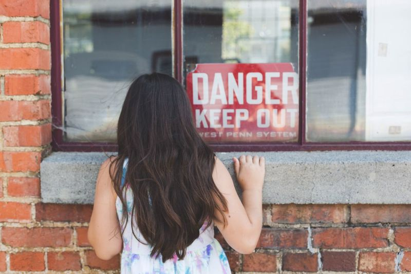 One Person Text Long Hair Rear View Outdoors Building Exterior Real People Day Built Structure Architecture People Adult Sign Danger Keep Out Window