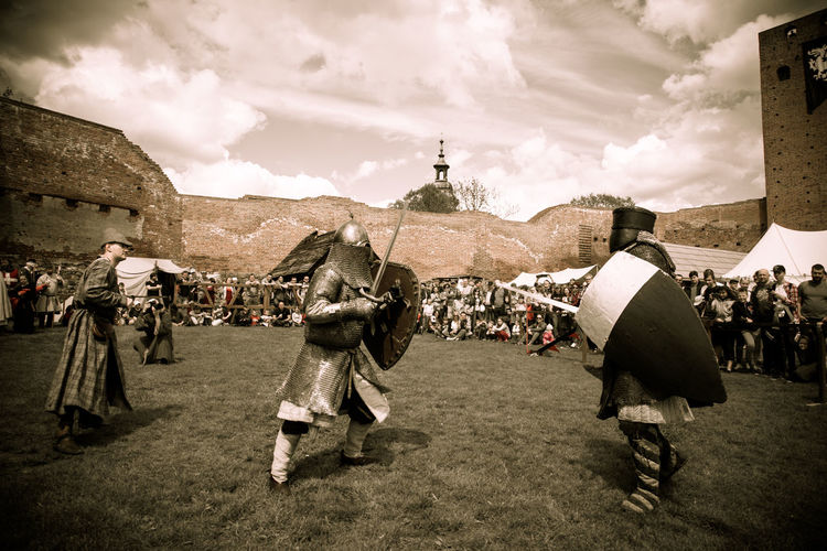 Kinghts duel during XI knights tournament Castle Cloud Czersk Day Due Field Grass Historical Building Historical Reenactment Kinghts Large Group Of People Men Outdoors People Real People Sky Sky And Clouds Tournament