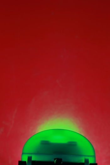 Close up transparency green lamp on red background Beautiful Bright Colors Green Isolated Light Red Room Textures Background Beauty Colorful Electricity  Indoors  Muti Colored Night Object Shadow Studio Shot Texture Transparency Transparent