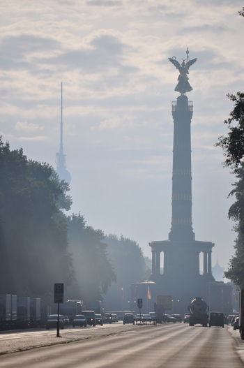 Victory column in Berlin Germany in the early morning hours. Architectural Column Architecture Building Exterior Built Structure City Cloud - Sky Day Fog History Monument Morning Sky No People Outdoors Sculpture Sky Statue Street Tourism Travel Travel Destinations Tree Victory Column Discover Berlin