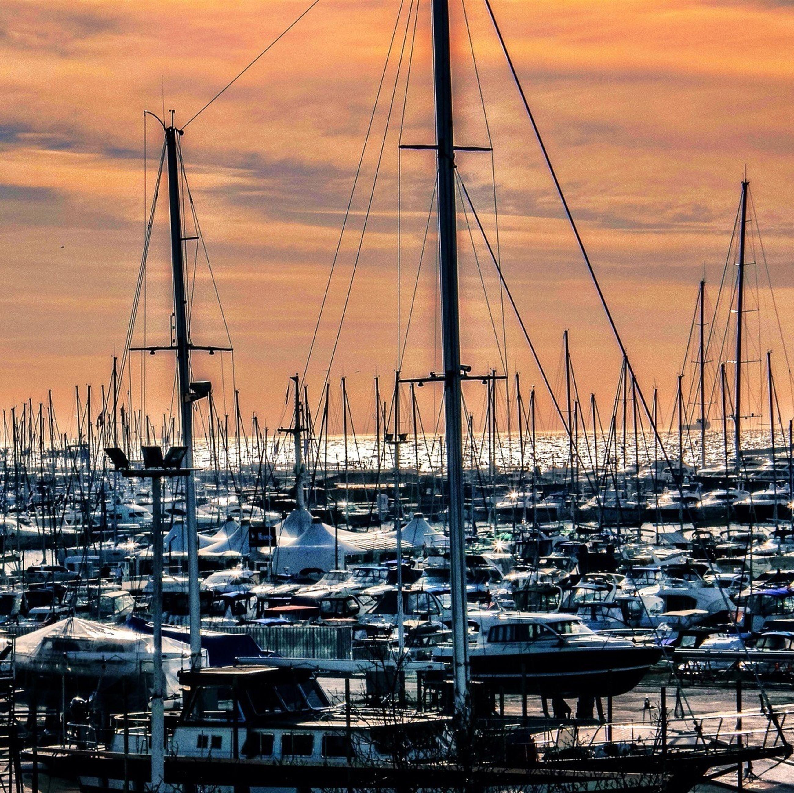 nautical vessel, mast, transportation, moored, boat, mode of transport, sunset, harbor, sailboat, water, sky, sea, cloud - sky, orange color, travel, marina, no people, outdoors, nature, cloud
