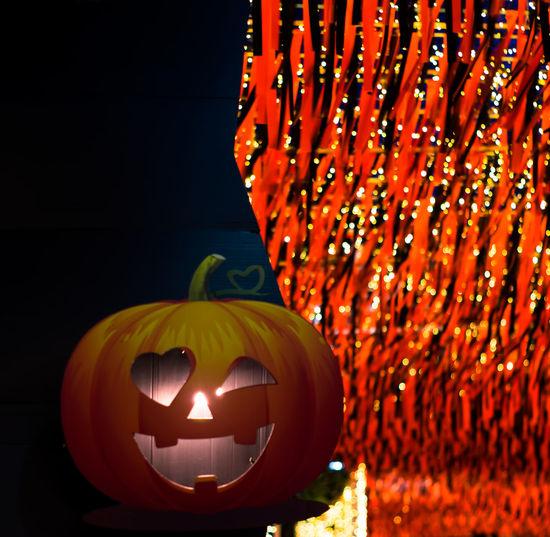 Close-up of illuminated jack o lantern on table