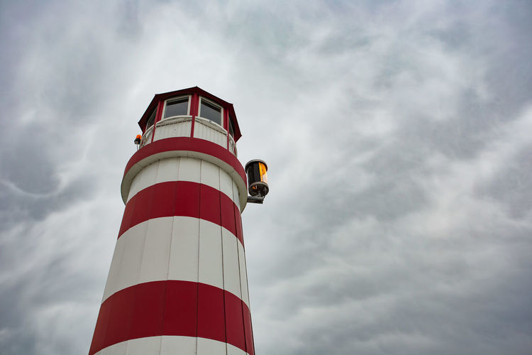 Lighthouse Built Structure Sky Protection Security Guidance Architecture Cloud - Sky Tower Lighthouse Safety Direction No People Outdoors Low Angle View Lighting Equipment