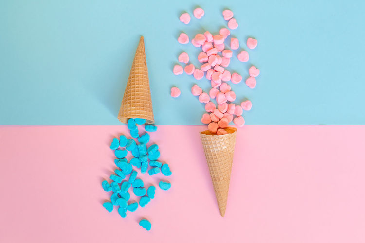 Close-up of ice cream against colored background