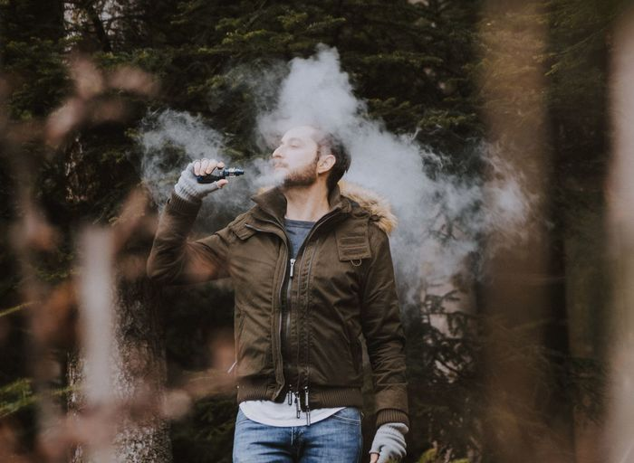 head in the clouds Vape VapeLife Motion Standing Fun Happiness Activity Mid Adult Smoking Tousled Hair Natural Beauty Hair Toss