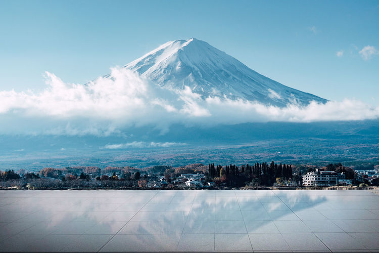 Sky Mountain Beauty In Nature Scenics - Nature No People Nature City Cloud - Sky Landscape Architecture Snow Environment Volcano Cold Temperature Snowcapped Mountain Building Exterior Day Built Structure Outdoors Tranquil Scene Cityscape Mountain Peak