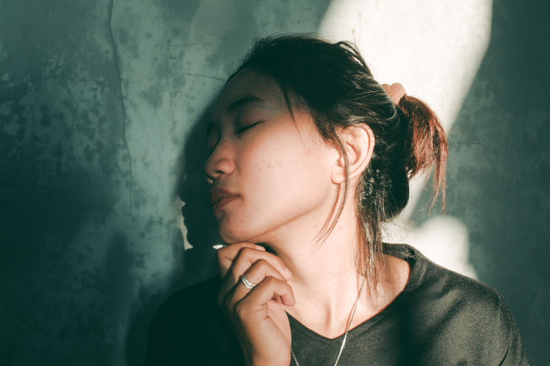 ASIA Alone Asian  Lights Rethink Things The Week On EyeEm Woman Day First Eyeem Photo Girl Girls Indoors  Light And Shadow Light And Shadows One Person People Portrait Real People Sad Sad & Lonely Sad Face Sadness Shadow Women Young Adult