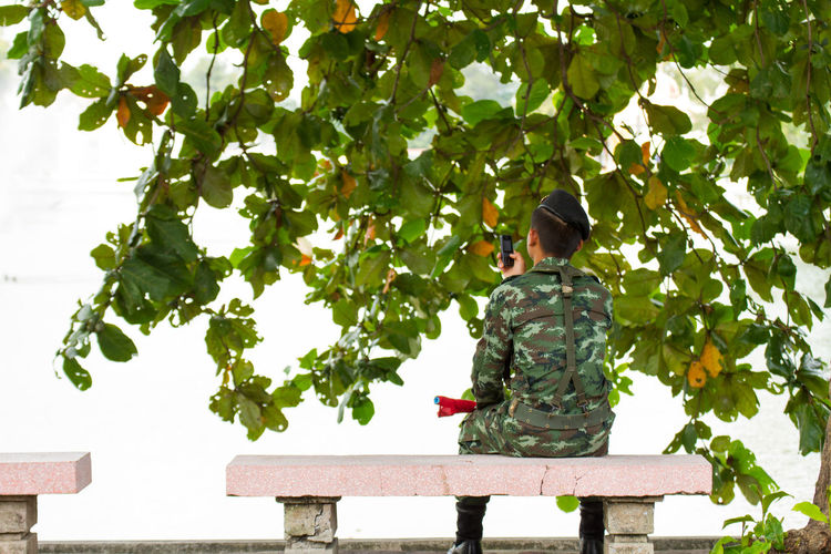 Rear view of boy against clear sky