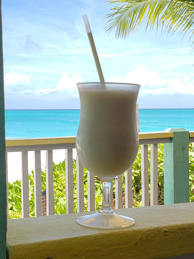 Piña colada at The Flamingo Cafe in Turks and Caicos Islands Turks And Caicos Turks And Caicos Islands Beach Cocktail Drink Drinking Glass Drinking Straw Food And Drink Freshness Glass Horizon Horizon Over Water Household Equipment Land No People Outdoors Refreshment Sea Sky Straw Table Tropical Climate Tropical Drink Turks And Caicos Beach Water