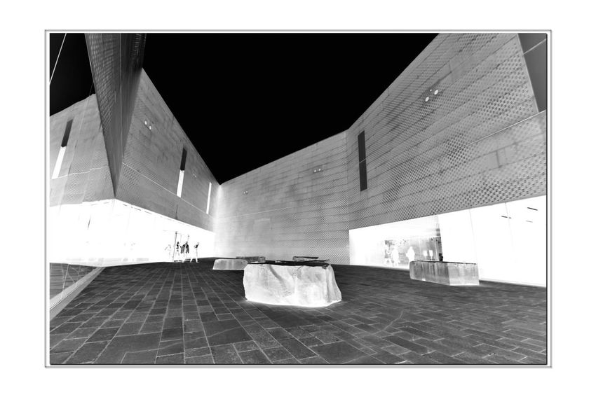All About Angles 6 DeYoung Museum Courtyard  Fine Arts Museum Golden Gate Park Bnw_friday_eyeemchallenge Bnw_corner Monochrome_Photography Monochrome Black & White Black & White Photography Black And White Black And White Collection  Illuminated Inverted Architecture Architectural Detail Perforated & Dimpled Copper Plates Façade Drawn Stones Seating New Museum Opened 2005 Replaced 1895 Original Building Severely Damaged 1989 Loma Prieta Earthquake People Walking  Building Exterior Historic Location Modern Art The Architect - 2018 EyeEm Awards