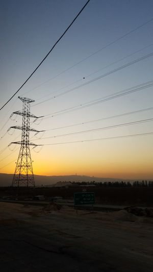 Sunset Silhouette Business Finance And Industry Sky No People Cable Beauty In Nature Landscape Outdoors Flying Bird Nature Technology Clear Sky Water Dayelectricity high wires energy environment