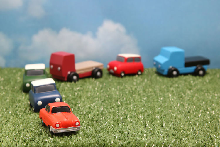 Close-up of toy cars on grass