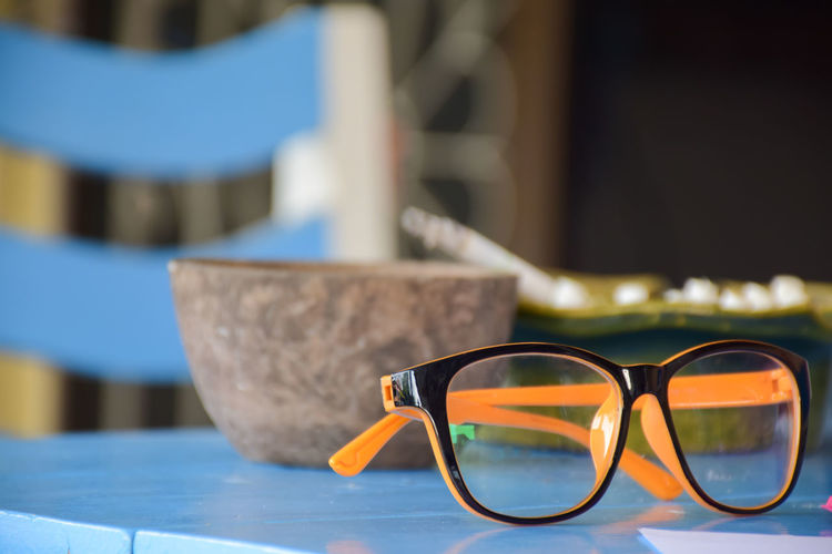 Close-up of sunglasses on table at swimming pool
