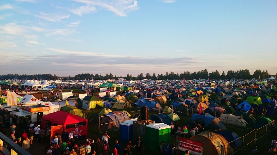 High Angle View Of Tents And People At Festival Against Sky