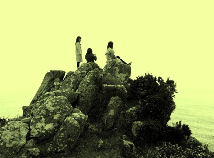 Friend's Forever! Asian Girls Beauty In Nature Cliff Cornwall Cornwall Walks Friends Girls King Of The Castle Looking Down On A Mountain On Top Of The World Outdoors Rock Rock - Object Rock Formation Scenics Tranquil Scene Tranquility