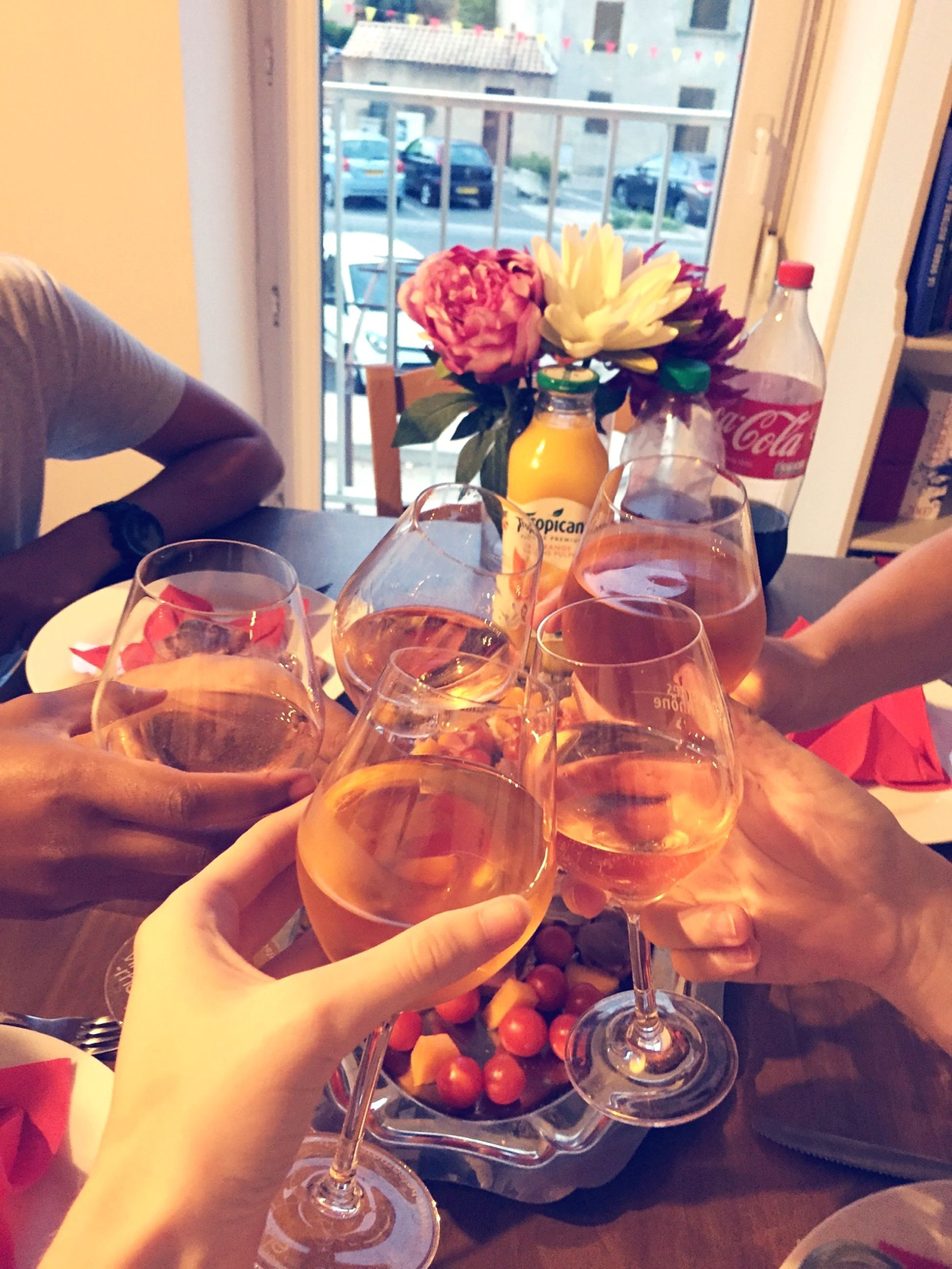 food and drink, person, indoors, lifestyles, holding, drink, freshness, table, leisure activity, refreshment, drinking glass, part of, restaurant, cropped, food