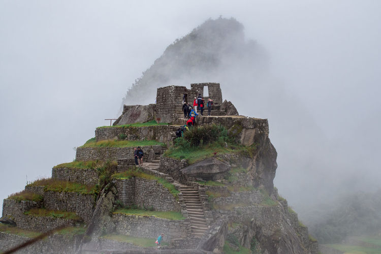 Fog Real People Travel Tourism Nature Men Leisure Activity Sky Lifestyles Group Of People Mountain Travel Destinations Day Beauty In Nature People Architecture Activity History Tourist Outdoors Machu Picchu