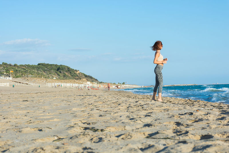Beach Land Sea Sky Water Leisure Activity Real People Lifestyles Beauty In Nature Sand One Person Full Length Nature Scenics - Nature Day Young Adult Standing Casual Clothing Outdoors Woman Woman Portrait Woman Who Inspire You Woman Power Woman Of EyeEm