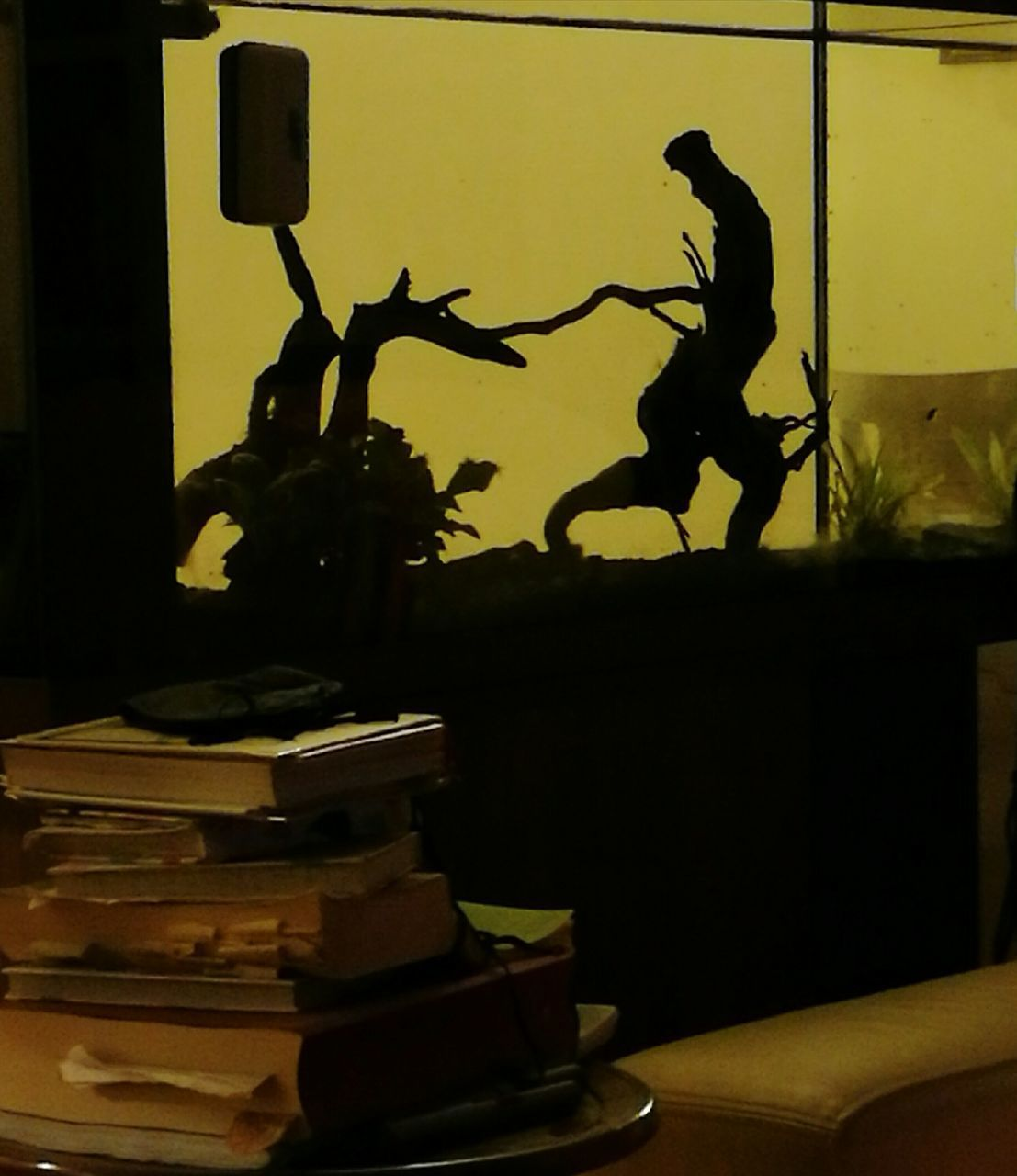 book, publication, table, stack, indoors, people, silhouette, representation, activity, human representation, technology, balance, men, male likeness, creativity, real people, nature, leisure activity