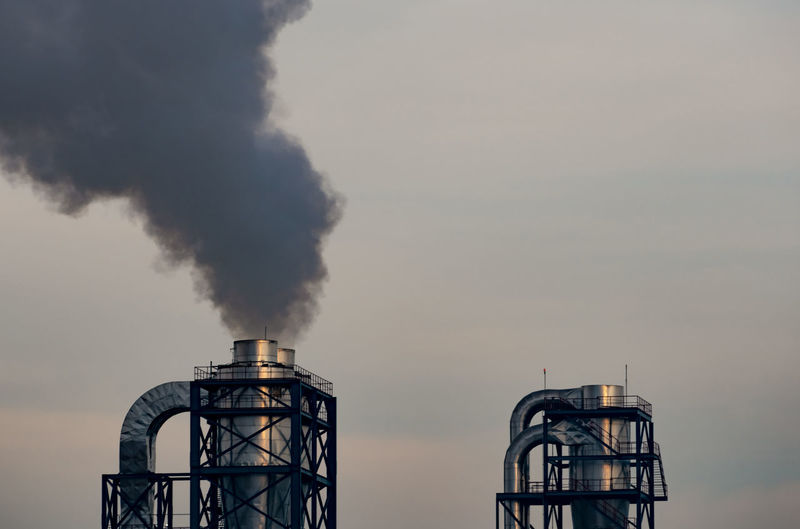 Air pollution from factory. black smoke from chimney of industrial pipe. global warming problem