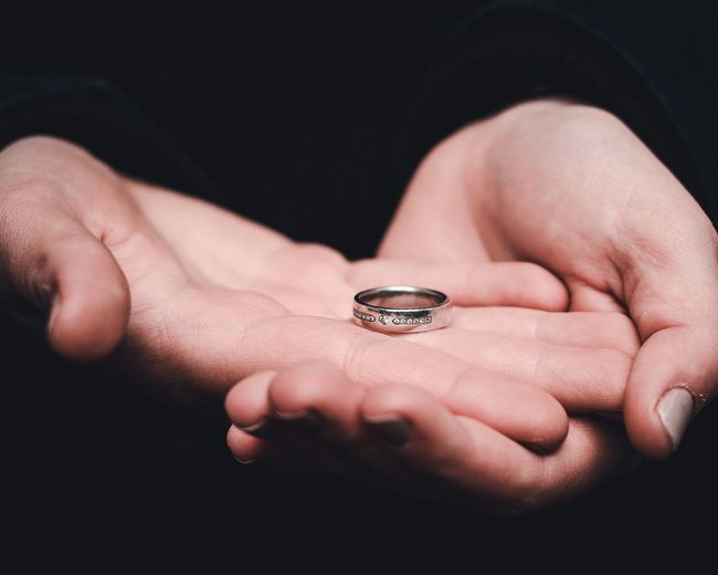 Cropped Image Of Woman Holding Ring