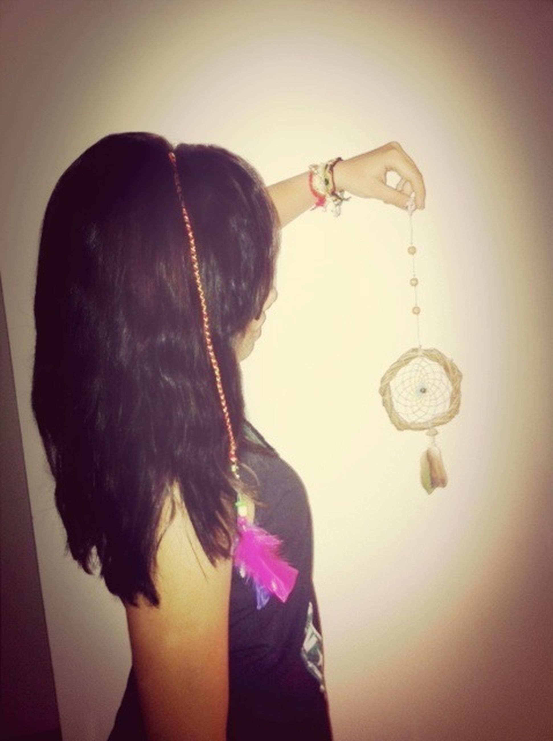 lifestyles, indoors, leisure activity, young adult, headshot, rear view, long hair, young women, person, casual clothing, standing, waist up, head and shoulders, holding, front view, side view, black hair
