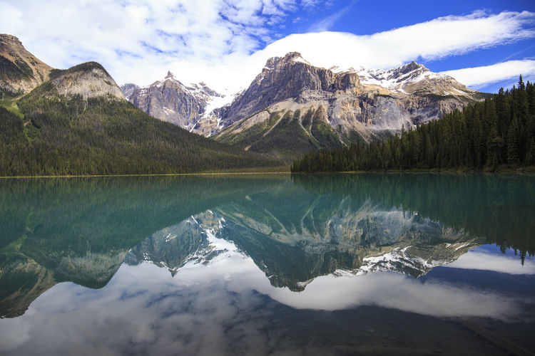 perfect tranquility Adventure Beauty In Nature Canada Canadian Rockies  Cloud - Sky Emerald Lake Idyllic Lake Landscape Mountain Mountain Range Nature No People Reflection Reflection Lake Rocky Mountains Scenics Sky Tranquil Scene Tranquility Travel Destinations Tree Water YOHO Yoho National Park