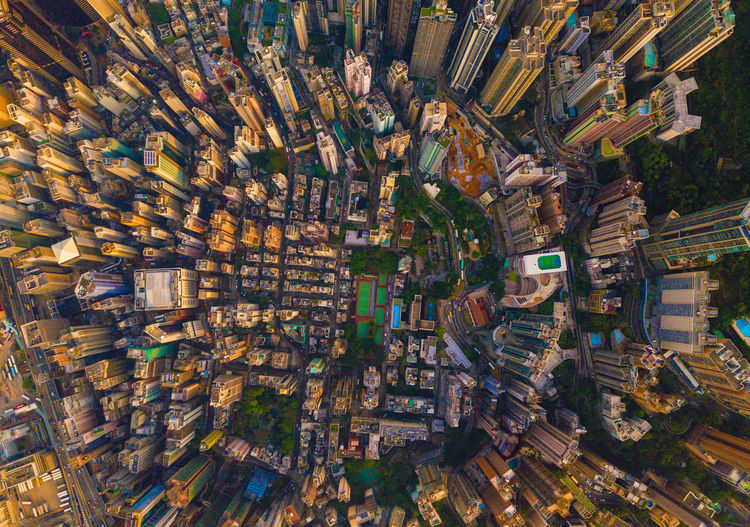 Aerial view of Hong Kong Downtown, China. Financial district and business centers in smart city in Asia. Top view of skyscraper and high-rise buildings at sunset. Top view Network Connection City Cityscape Hong Kong Downtown China Financial District  Skyscrapers Buildings Architecture Business Aerial View Drone  Top View ASIA Victoria Building Exterior Built Structure Building High Angle View Travel Destinations Crowd Full Frame Crowded Residential District City Life Day Street Backgrounds Transportation Office Building Exterior Skyscraper