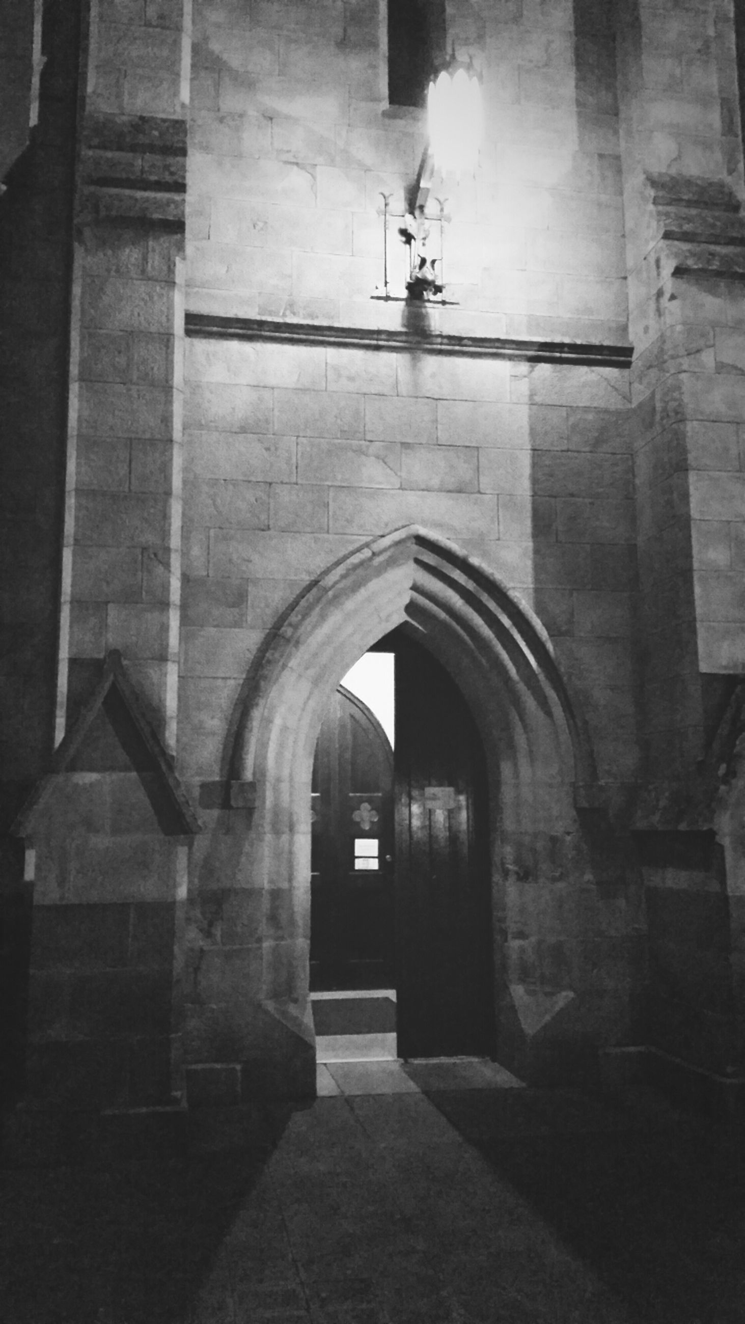 architecture, built structure, the way forward, arch, building exterior, indoors, building, illuminated, corridor, empty, lighting equipment, diminishing perspective, wall - building feature, narrow, no people, walkway, ceiling, archway, absence, entrance