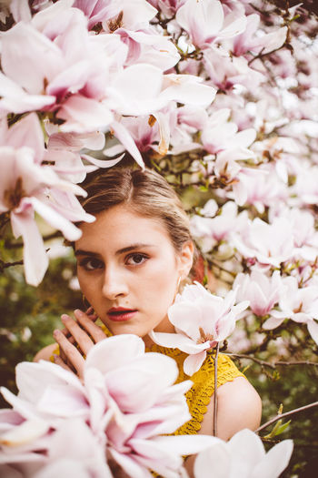 Portrait Of Young Woman Amidst Pink Flowers