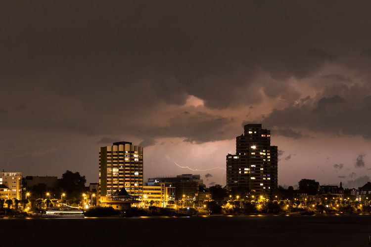 Lightning in the night Architecture Building Exterior Built Structure City City Lights Cityscape Cityscape Cloud - Sky Clouds And Sky Cloudscape Cologne Cologne , Köln,  Illuminated Lightning Lightning Storm Lightning Strikes Night No People Outdoors Sky Skyscraper Thunderstorm Urban Skyline Waterfront
