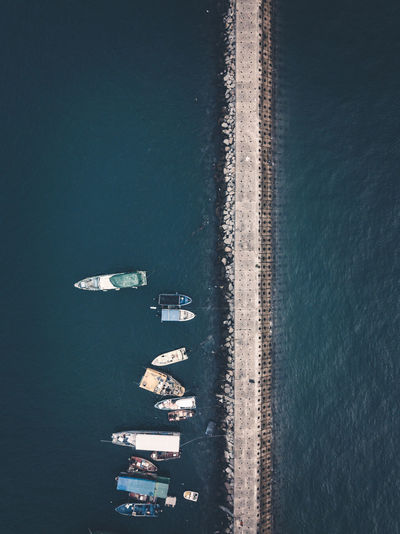 Small fishing boats near the wave barrier in aberdeen bay hong kong Water Nautical Vessel Transportation Sea High Angle View Mode Of Transportation Nature Day Travel Architecture Barrier Nature Waves Background Coastline Landscape Aerial View Air Drone  Photography Protection Horizon Outdoors Travel Rock