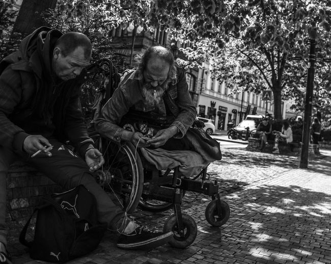 Adult Care Casual Clothing Day Females Full Length Leisure Activity Lifestyles Males  Medical Equipment Men People Real People Senior Adult Senior Men Senior Women Sitting Street Streetphoto_bw Streetphotography Togetherness Two People Wheelchair Women