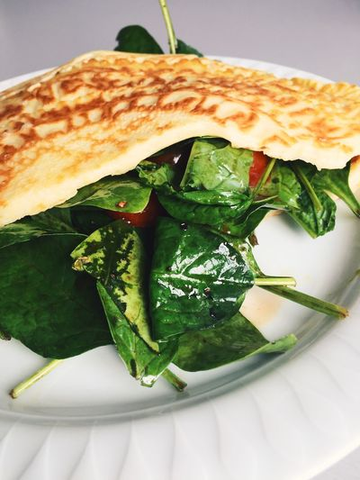 High angle view of spinach omelet in plate on table at home