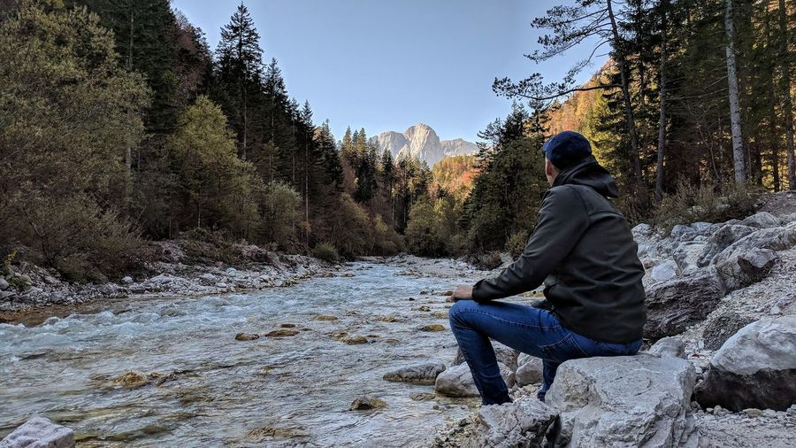 Sitting One Person Men Leisure Activity Cold Temperature Nature Winter People Outdoors Full Length One Man Only Adult Day Child Real People Only Men Sky Young Adult EyeEm Selects Adult Mountain Range Landscape Sitting Mountain Travel Destinations