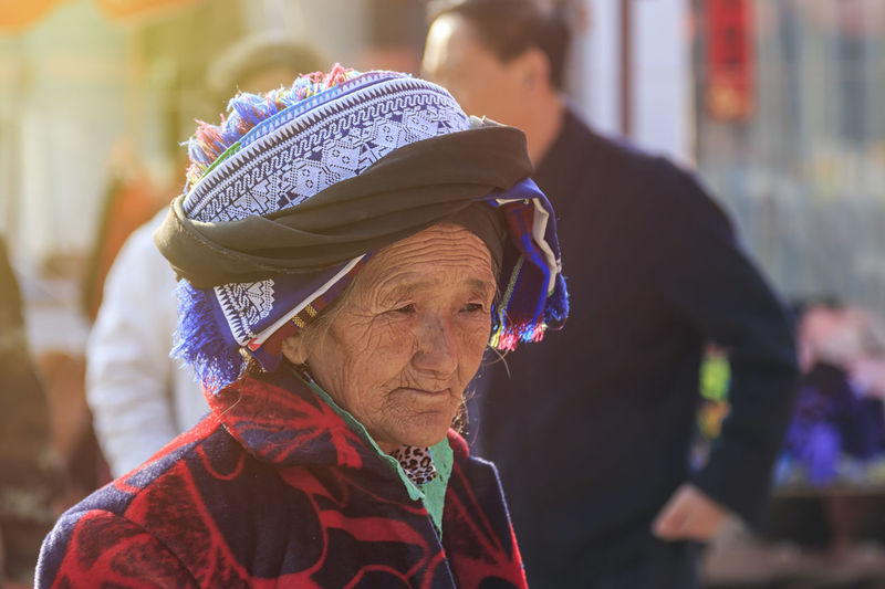 Shaxi, China - February 22, 2019: Portrait of an old Chinese woman in the Friday market in Shaxi old town Shaxi China ASIA Yunnan Yunnan ,China Market South Silk Road Tea Horse Road Minority Ethnic Group Old Town Kunming, China Landscape People Night Teather Old Adult Women Senior Adult Headshot