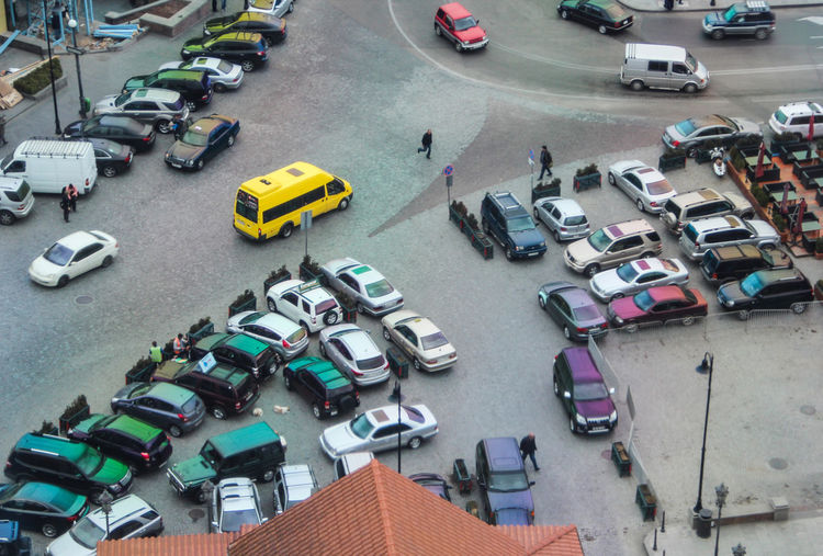 High angle view of people and cars on street in city