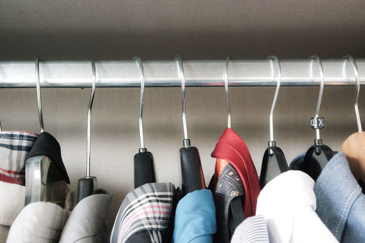 Close-up of clothes on coat hangers in row