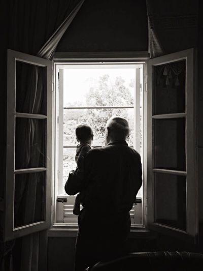 Two Is Better Than One Light And Shadow Black & White Shadowplay Escape Window Into The Light Black And White Portrait Black And Light Textures And Surfaces Love Without Boundaries Looking Out Of The Window Curtains Portraitmood Grandpa Baby Darkness And Light Portrait Of A Man  Conceptual Time And Space Expression Looking Into The Future Emotion What's On The Roll People And Places