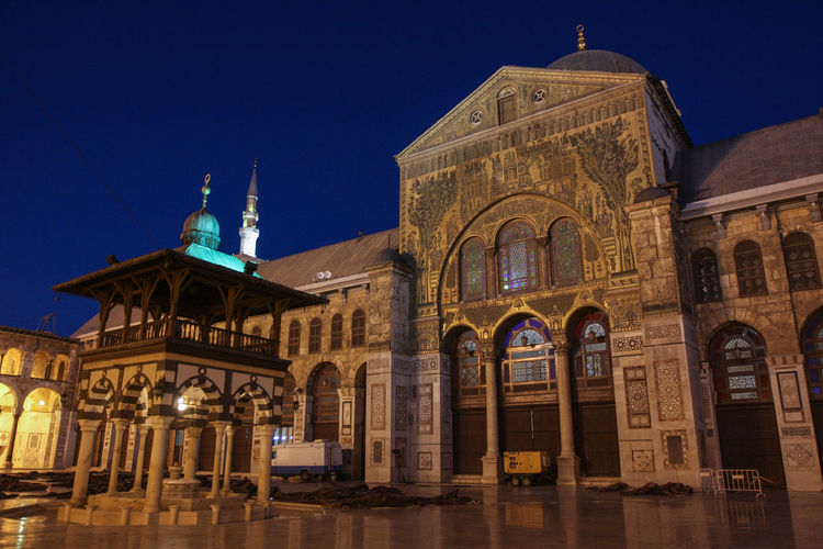 Cathedral against blue sky at night