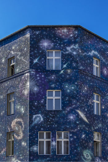 Berlin's Colors. FILIPPI GIULIA PHOTOGRAPHY. Architecture Astronomy Berlin Blue Building Exterior Color Day Germany Graffiti House Light And Shadow No People Outdoors Photographer Photography Sky Space Spray Paint Stars Street Street Art Street Photography Vibrant Color Window World
