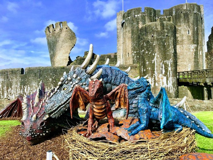 Caerphilly Castle, Dragons Baby Dragon Wales Castle Wales UK Travel Destinations Old Ruin No People Nature Built Structure Architecture Ancient Sunlight Outdoors Building Exterior Day History Low Angle View Tourism Building The Past Cloud - Sky Religion Sky Travel