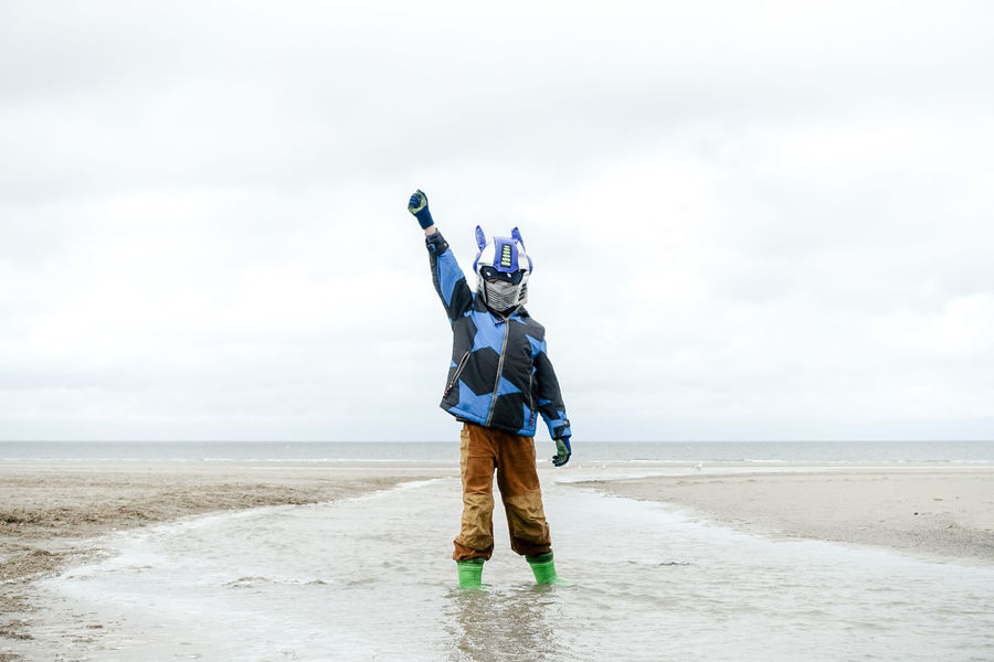 Rise of a new generation... Beach Blue Freedom Front View Horizon Over Water Mask Nature One Person Outdoors Rise And Shine Sea Sky Water Young Youth Youth Of Today Resist The Great Outdoors